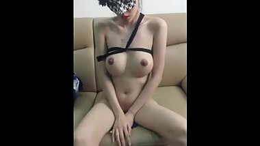 South Korean half-breed beauty sits on the sofa kneading milk groin