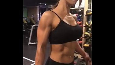 Korean Muscle Gal curling biceps with some veins
