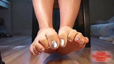 Asian girl's silver toe spread and dangling