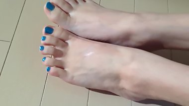 Japanese girl's blue toes display