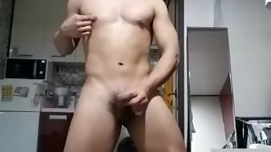 Korean muscle guy wanking and cumming